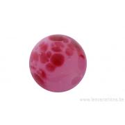 Perle en verre d'artisan -ronde - rose transparente à pois rose foncé